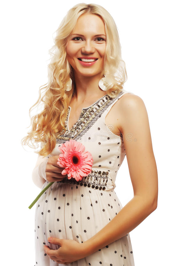 Schwangere Frau der Junge mit gerber lizenzfreie stockbilder