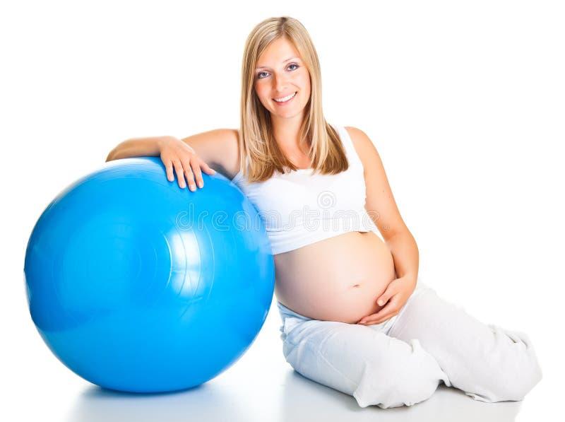 Schwangere Frau excercises lizenzfreies stockbild