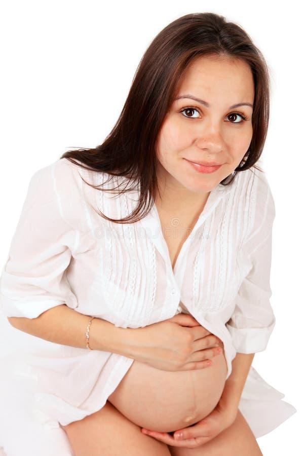 Schwangere Frau mit überreicht Bauch lizenzfreie stockbilder