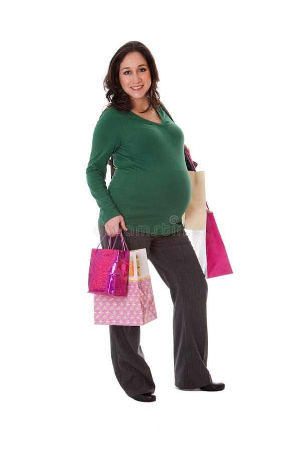 Schwangere Frau mit Einkaufenbeuteln stockfoto