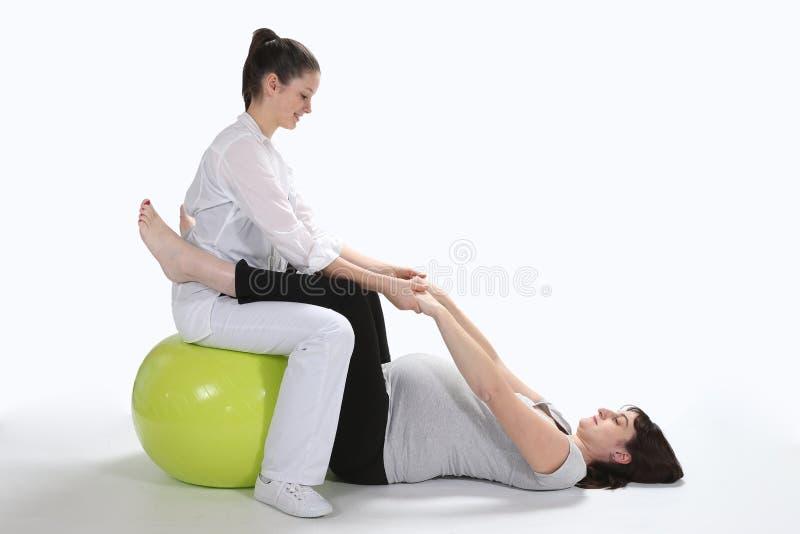 Schwangere Frauen und Krankenschwestereignung stockfoto