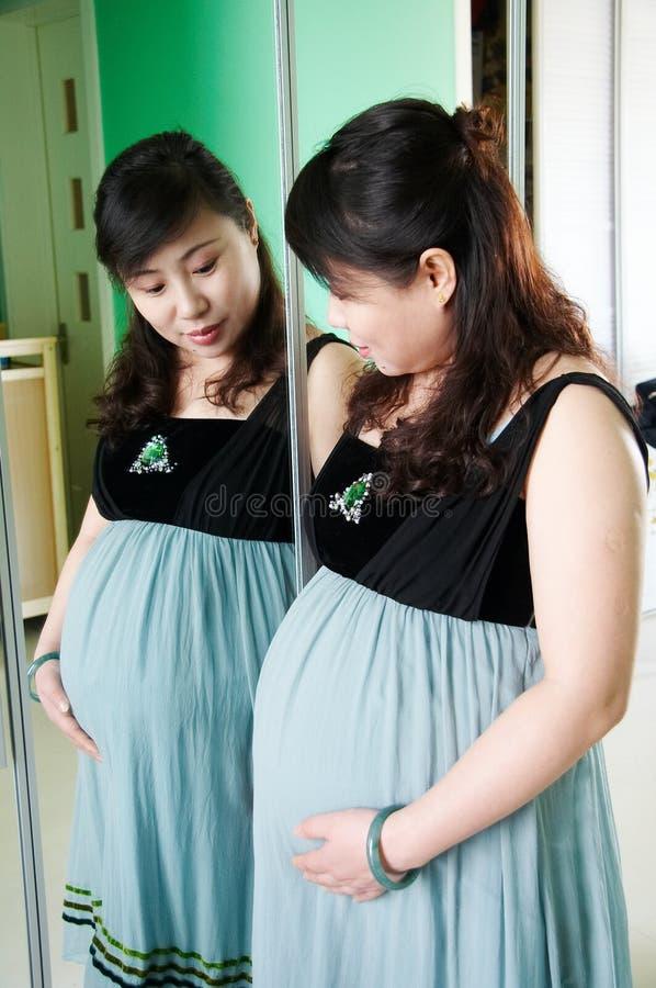 Schwangere Mamma stockbilder