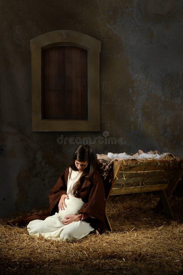 Schwangere Mary und die Krippe stockbild
