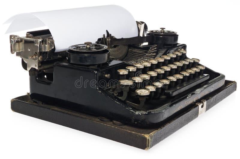 Schwarze antike Schreibmaschine, mit weißem leerem Blatt Papier stockbilder