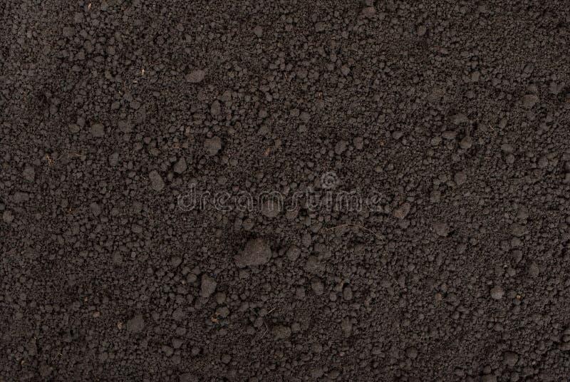 Schwarze Bodenbeschaffenheit stockbild