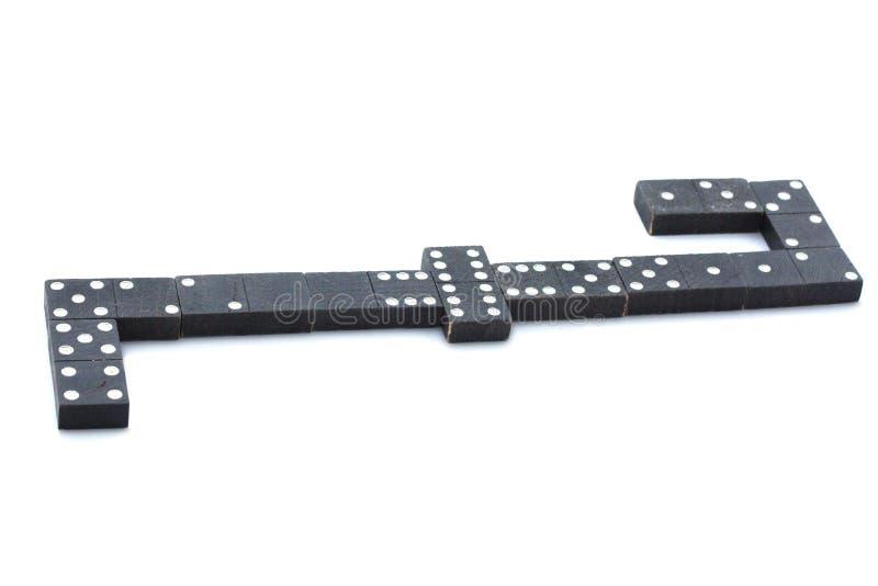Schwarze Dominos lokalisiert auf weißem Hintergrund stockfotos
