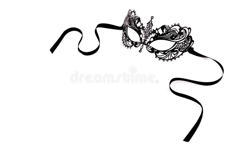 Schwarze empfindliche Spitzemaske auf einem weißen Hintergrund Schwarze Metallkarnevalsmaske lizenzfreie stockfotografie
