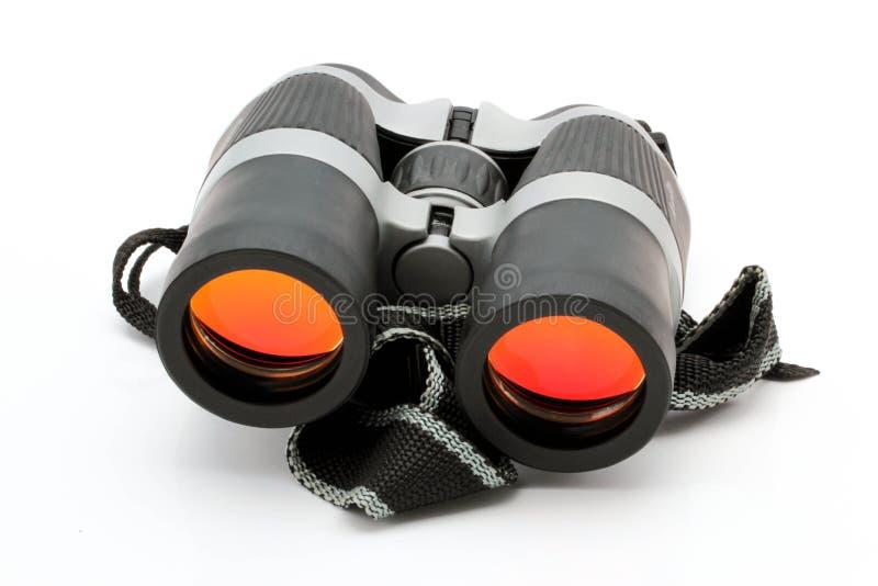 Schwarze Ferngläser mit orange Linse stockfotos