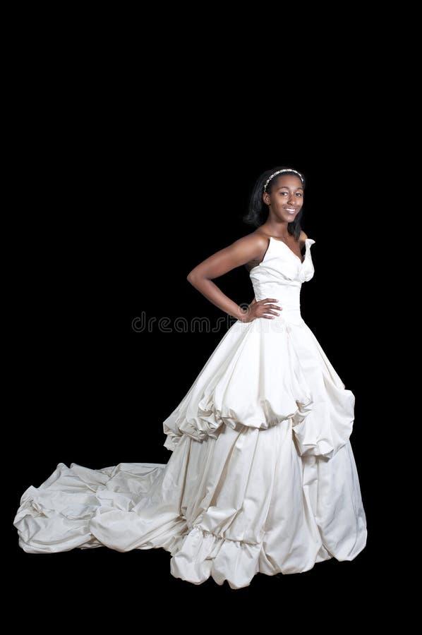 Schwarze Frau im Hochzeitskleid stockfotos