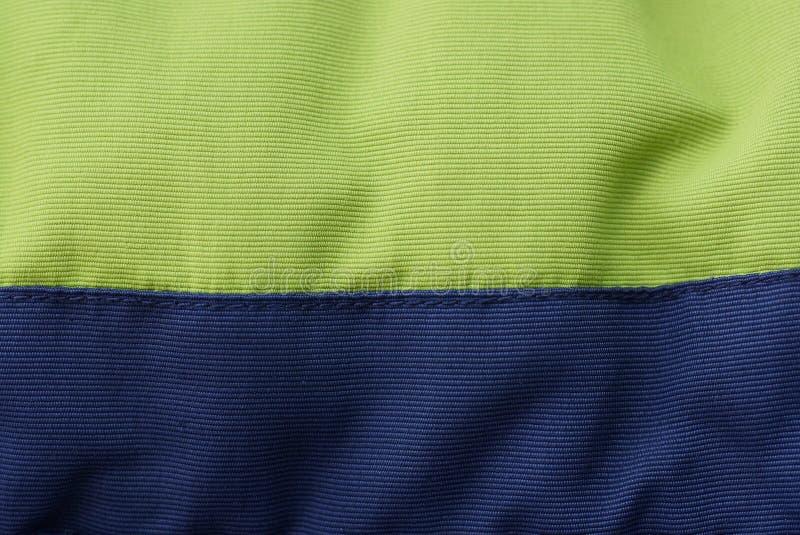 Schwarze grüne Gewebebeschaffenheit von einem Stück der zerknitterten Angelegenheit lizenzfreies stockbild