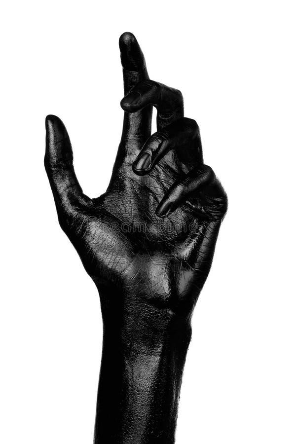 Schwarze Hand auf dem weißen Hintergrund, lokalisiert, Farbe lizenzfreies stockfoto