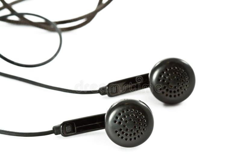 Schwarze Kopfhörer auf Weiß stockfotografie