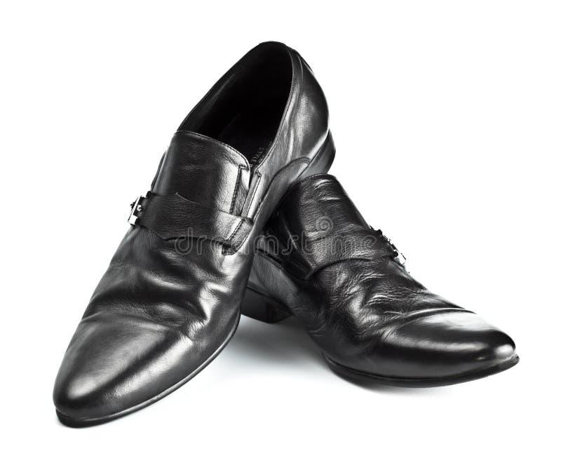 Schwarze männliche Schuhe mit Schnallen stockbilder