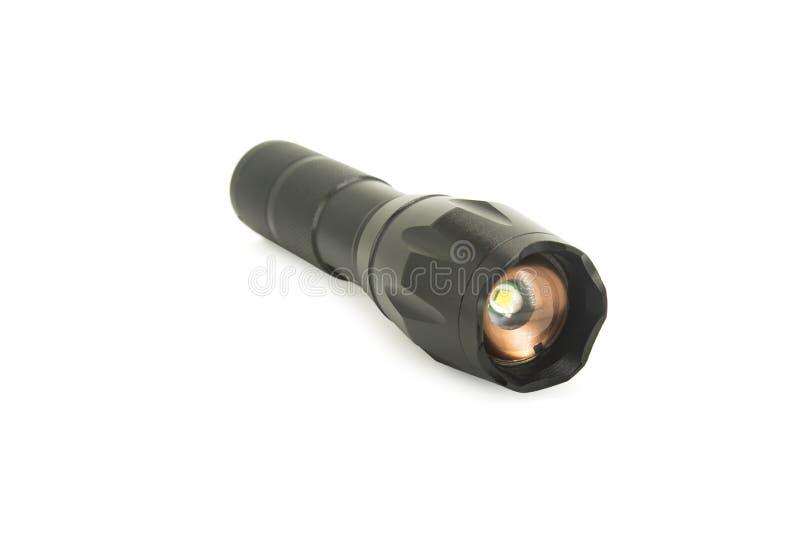Schwarze Metalltaschenlampe lokalisiert auf wei?em Hintergrund mit Beschneidungspfad lizenzfreie stockbilder