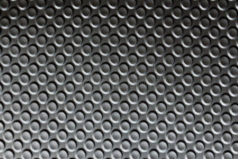Schwarze Plastikoberfläche mit rauer Beschaffenheit stockfoto