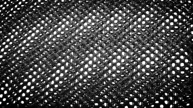 Schwarze Robe mit Löchern stockfotografie