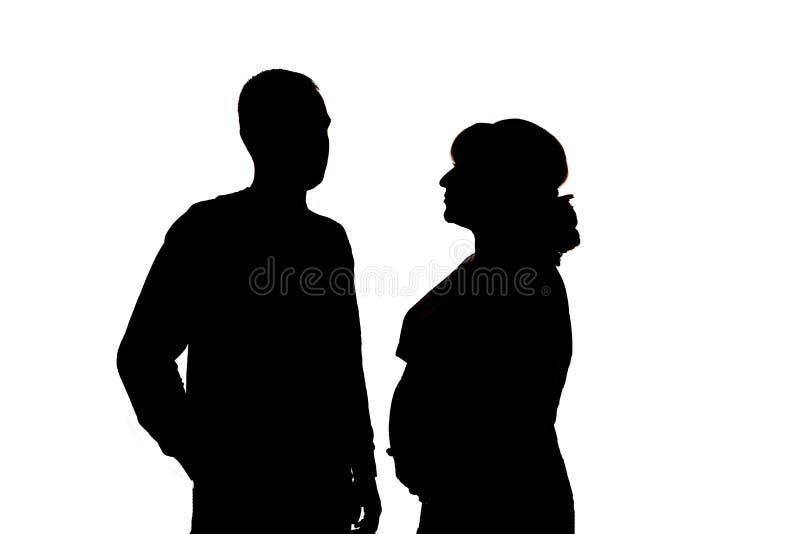 Schwarze Schattenbilder auf weißem Hintergrund Isoliert lizenzfreie stockfotografie