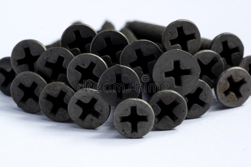 Schwarze Schrauben für Metallgebrauch lizenzfreie stockfotografie