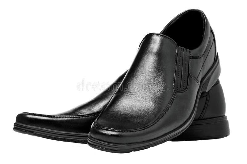 Schwarze Schuhe der Männer lizenzfreie stockfotos
