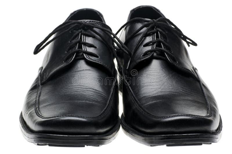 Schwarze Schuhe des Paarmannes stockfotografie