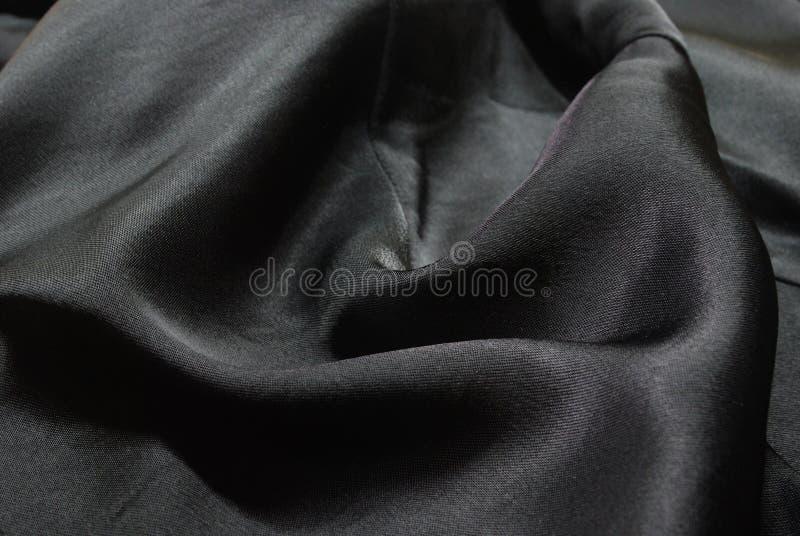 Schwarze Seide stockbilder