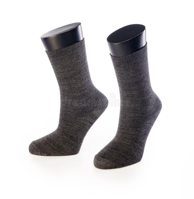 Schwarze Socke zwei auf Mannequin für Sport auf weißem Hintergrund lizenzfreie stockbilder