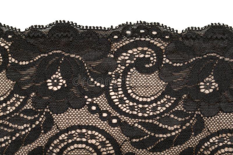 Schwarze Spitze und beige Muster stockfotografie