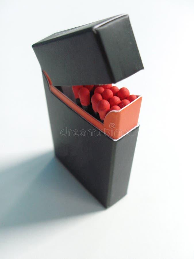 Schwarze Streichholzschachtel schwarzes Match lizenzfreie stockfotografie