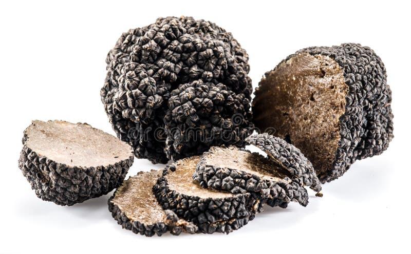 Schwarze Trüffeln lokalisiert auf einem Weiß stockfoto