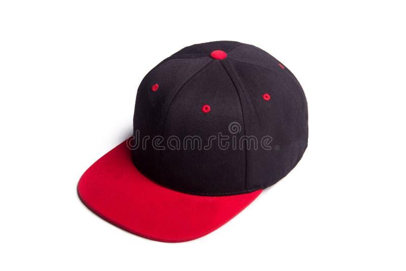 Schwarze und rote Baseballmütze lokalisiert lizenzfreie stockfotos