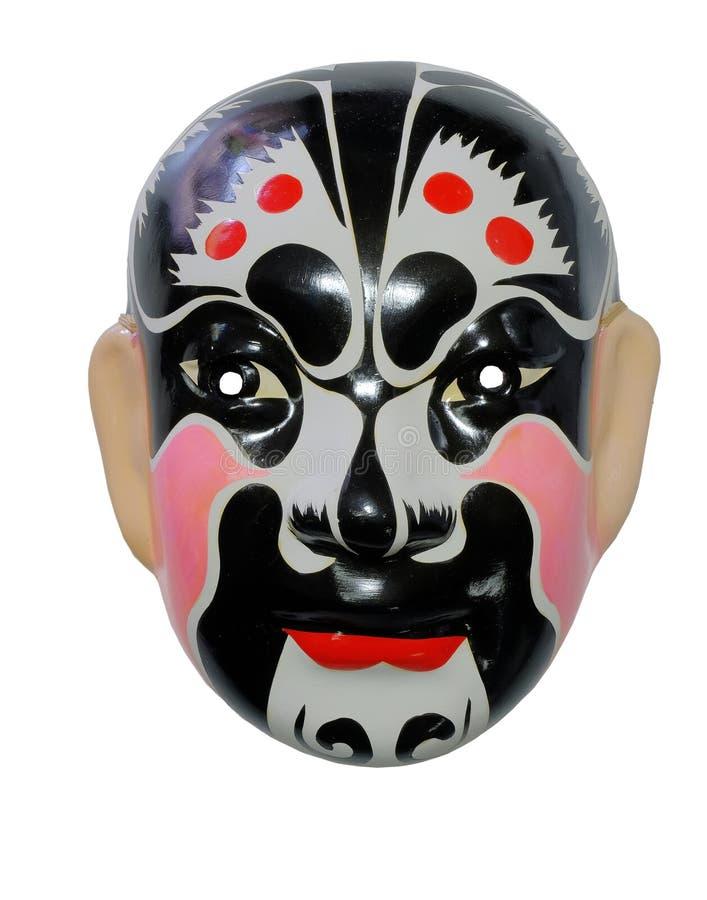 Schwarze und rote chinesische traditionelle Maske auf weißem Hintergrund lizenzfreies stockfoto