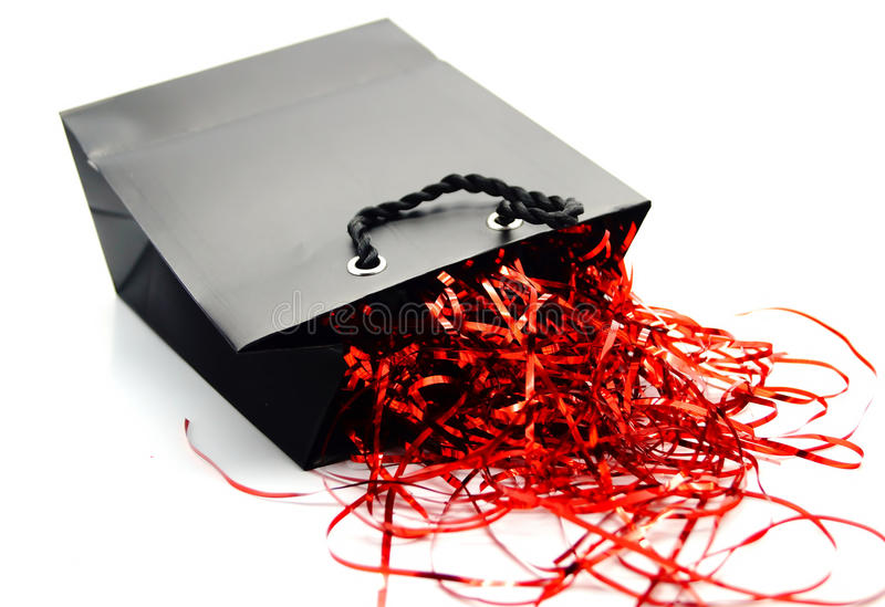 Schwarze und rote Geschenk-Tasche lizenzfreies stockbild