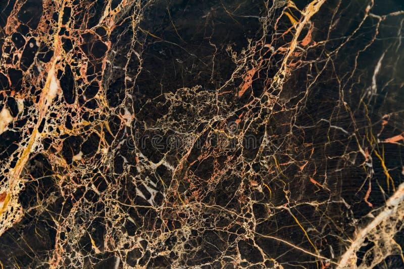 Schwarze weiße und orange Marmorhintergrundbeschaffenheit stockfotografie