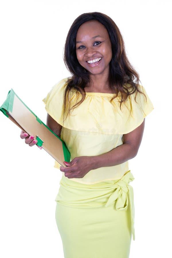 Schwarze weibliche Exekutive des amerikanischen Afrikaners, die sicher aufwirft stockfotografie