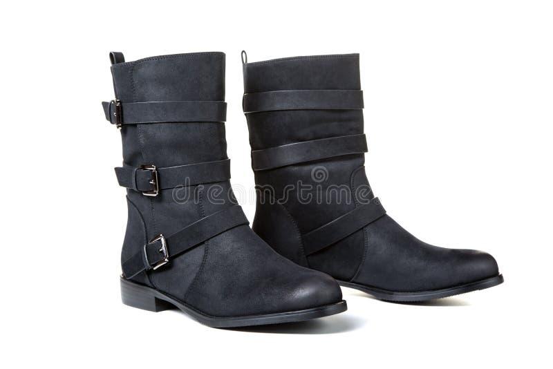 schwarze weibliche Stiefel lokalisiert auf Weiß lizenzfreie stockbilder