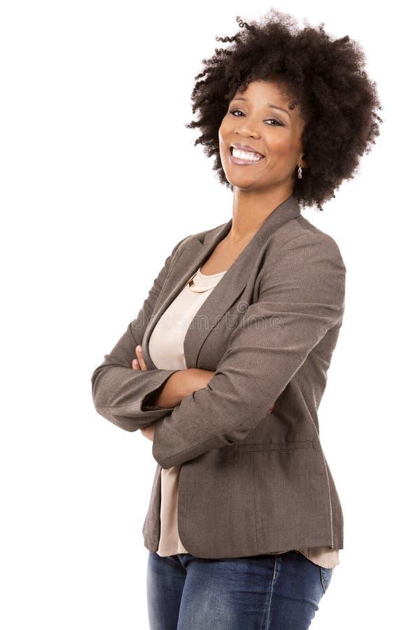 Schwarze zufällige Frau auf weißem Hintergrund lizenzfreies stockbild
