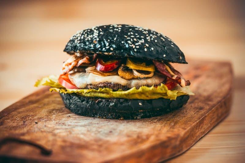 Schwarzer Burger stockfotos