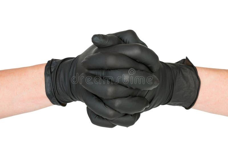 Schwarzer chirurgischer Latex-Handschuh stockfoto