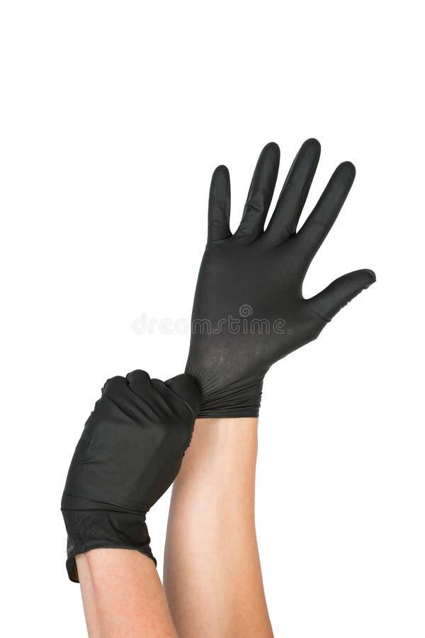 Schwarzer chirurgischer Latex-Handschuh lizenzfreie stockbilder