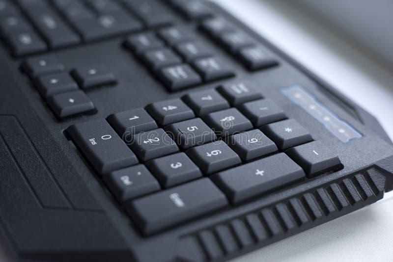 Schwarzer Computer verdrahteter Tastaturknopf stockbilder