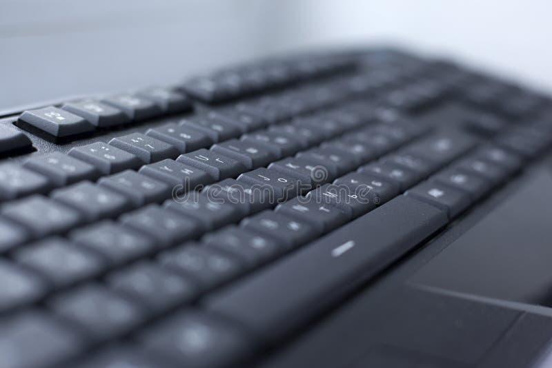 Schwarzer Computer verdrahteter Tastaturknopf stockbild