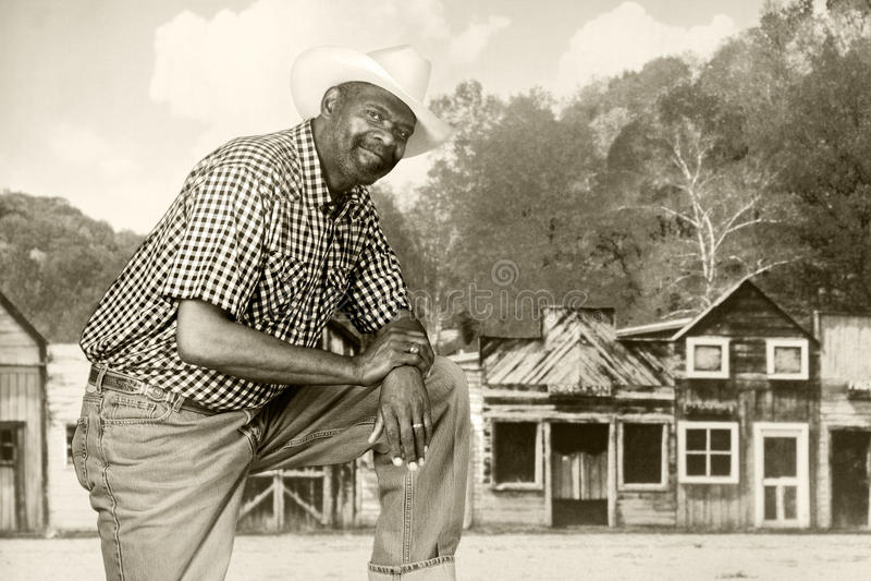 Schwarzer Cowboy im alten Westen stockfotos