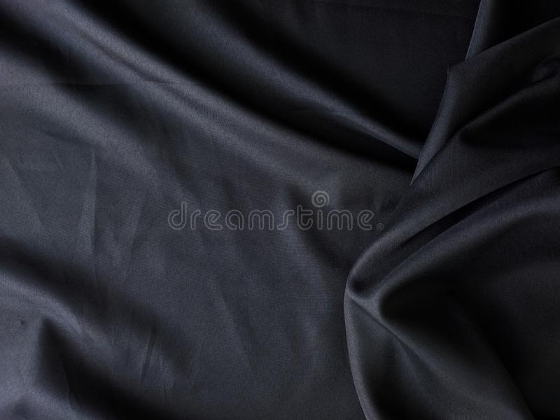 Schwarzer Gewebebeschaffenheitshintergrund, verwirrte Gewebebeschaffenheit, Textilindustriehintergrund stockbild