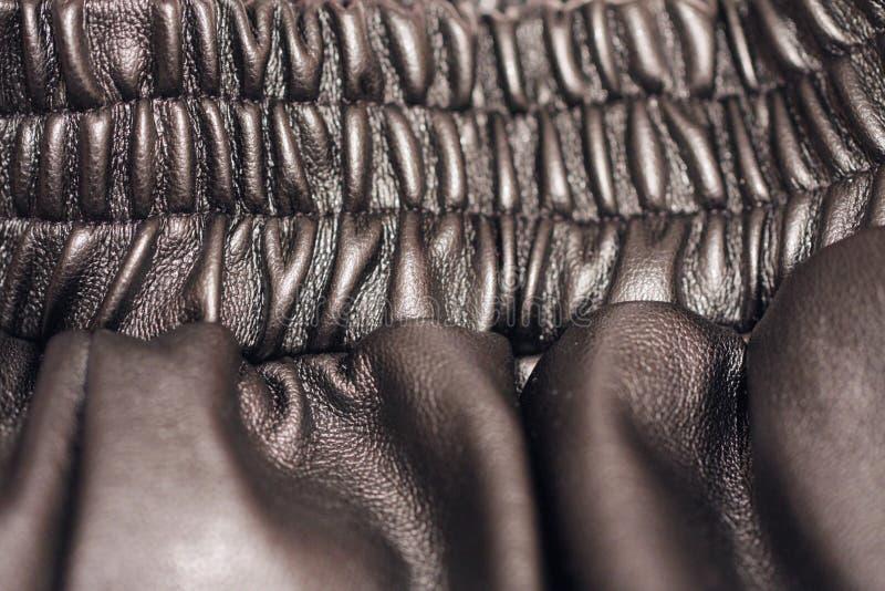 Schwarzer Hintergrund von Lederbekleidung lizenzfreies stockfoto