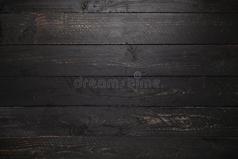 schwarzer Holztischbeschaffenheitshintergrund lizenzfreies stockbild