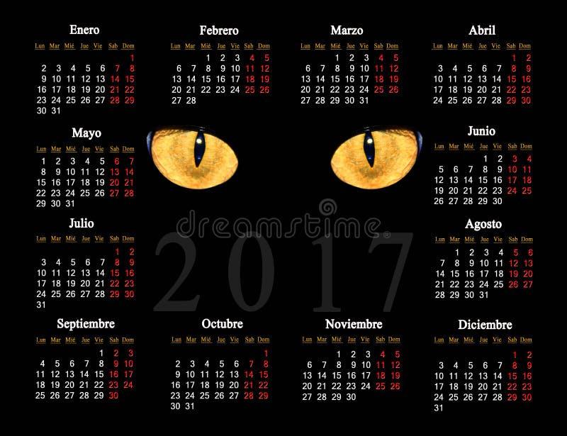 Schwarzer Kalender für 2017 mit Katzenaugen auf spanisch lizenzfreies stockbild