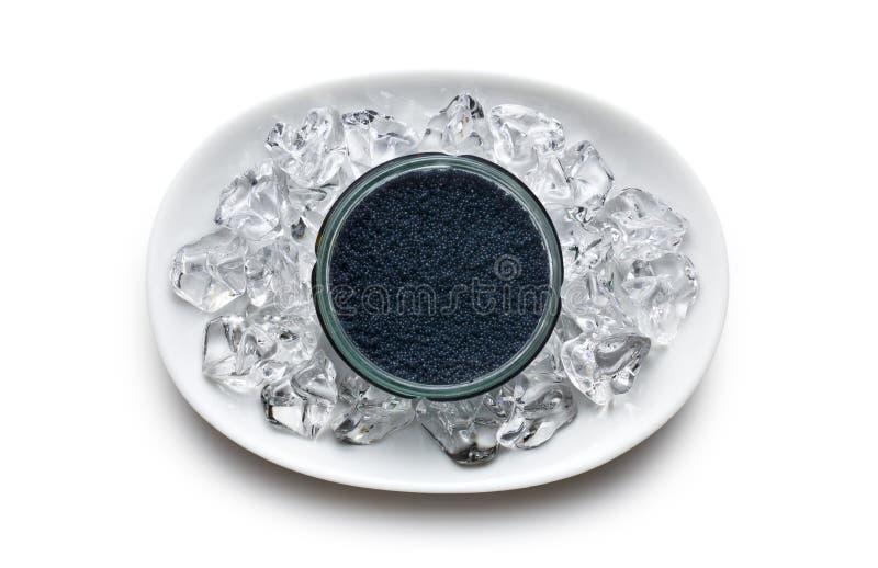 Schwarzer Kaviar im Glas lizenzfreies stockbild