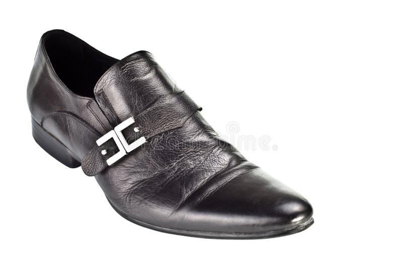 Schwarzer männlicher Schuh mit Schnalle lizenzfreie stockfotografie