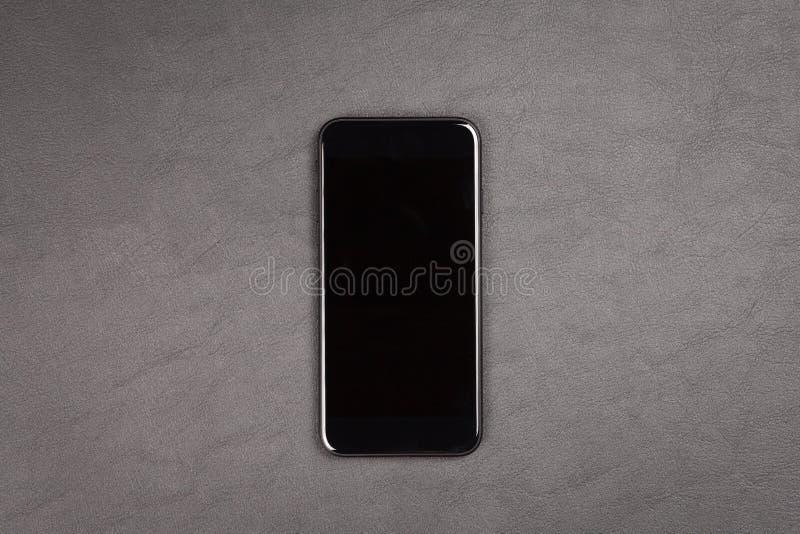 Schwarzer moderner Smartphone lizenzfreie stockfotografie
