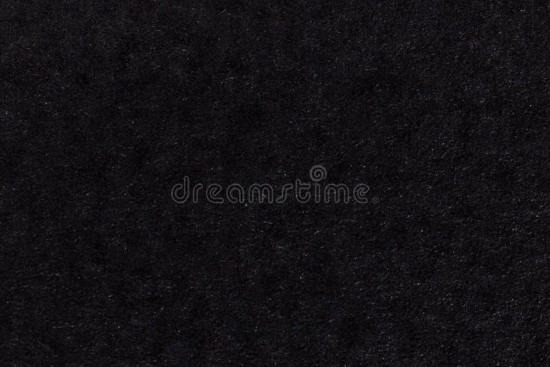 Schwarzer Papierbeschaffenheitshintergrund farbige Pappfasern und -korn leeres Raumkonzept lizenzfreies stockbild